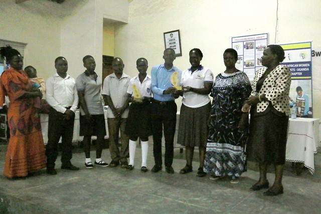 Mrs. Susan Opok Tumusiime, the FAWE Uganda Executive Director awarding Students and Teachers from Kurugutu Secondary School for their outstanding performance during the science competitions. Right – Mrs. Atim Mugenyi, FAWE Uganda Board Chairperson and the Head Teacher of Bwerangangi Girls S.S.