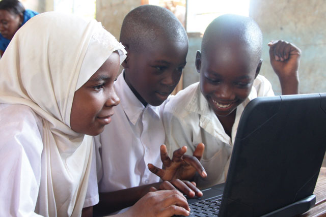 Kenya kids trying out computer lessons